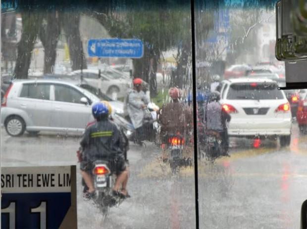 Malaysia Penang traffic in rain motor cycles