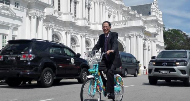 mah-hui-on-bike-after-resigning