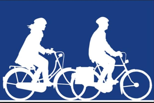 two-cyclists-white-figures-against-blue-backdrop